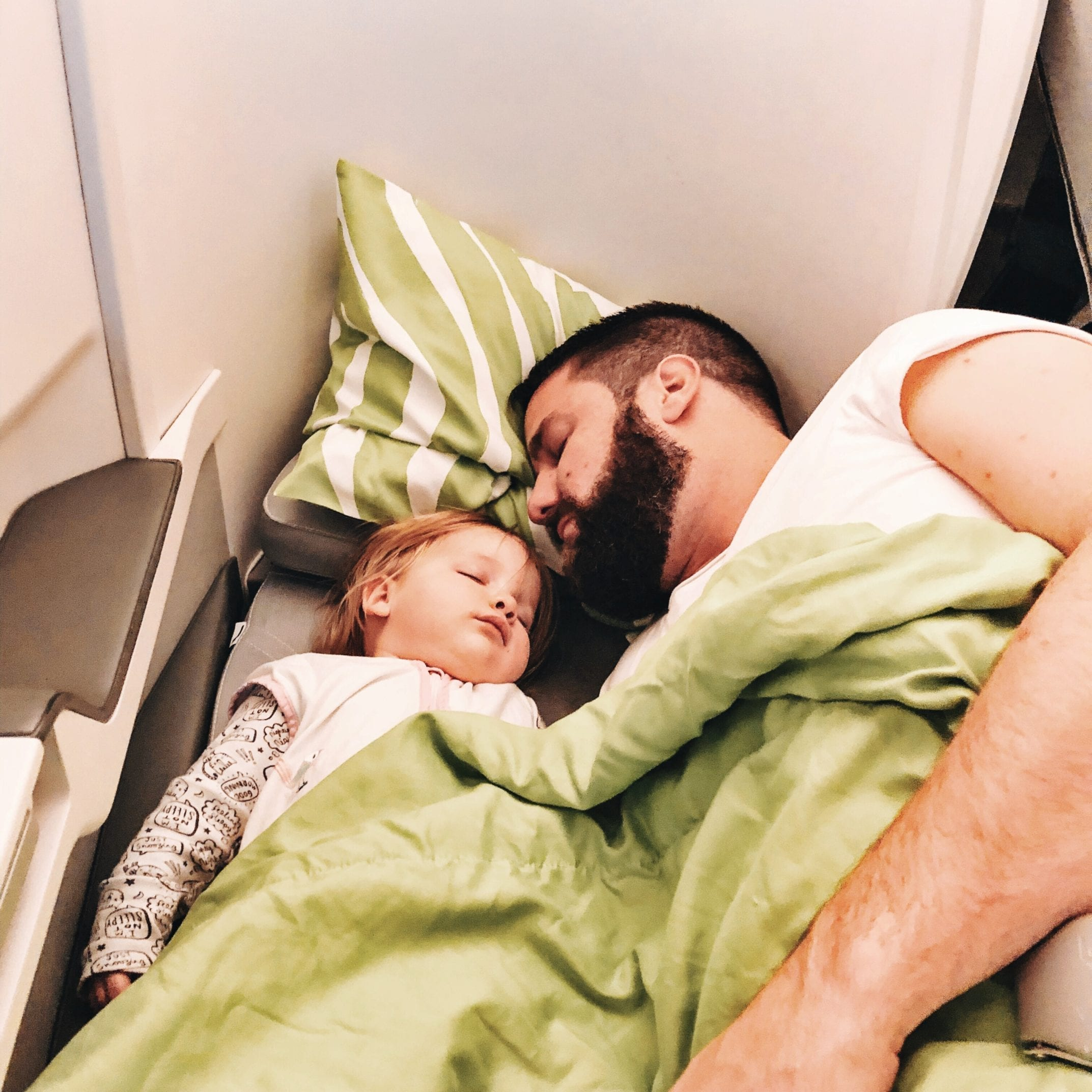 Tips and tricks how to survive a long haul flight with your toddler in tow
